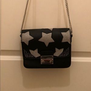 Black and sliver star bag
